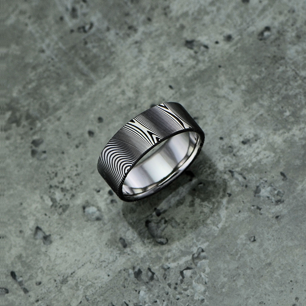 Pure Damascus steel ring, in a dark etch and flat profile. $990 + shipping.