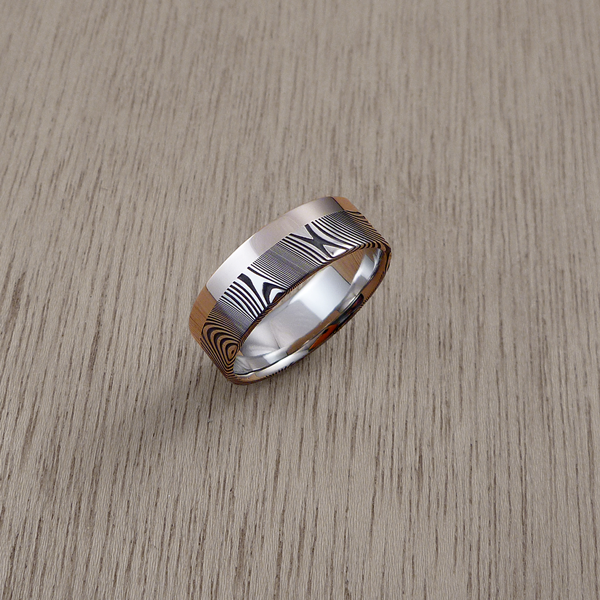 Damascus steel ring with a single 18ct white gold rail, in a dark etch and flat profile. $1550 + shipping.