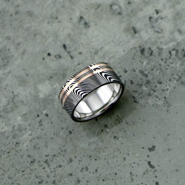 Damascus steel ring with 18ct rose gold inlays, in a dark etch and flat profile. $1550 + shipping.