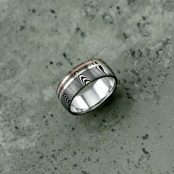 Damascus steel ring with an 18ct white and rose gold inlay, in a dark etch and round profile. $1550 + shipping.