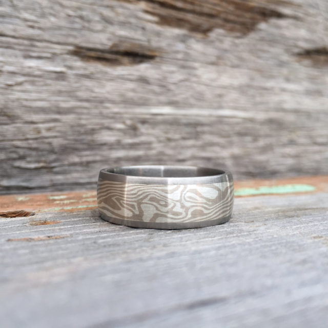 Mokume-gane ring with titanium liner and rails. Featuring white gold and silver mokume. POA - contact us for a quote.