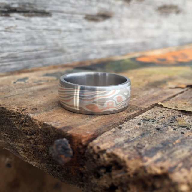 Mokume-gane ring with titanium liner and rails. Featuring white gold, rose gold and silver mokume. POA - contact us for a quote.