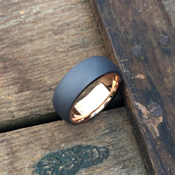 Sandblasted tantalum ring with 18ct rose gold liner. 7.5-8.5mm wide. From $1750 for sizes up to and inc. T + shipping.