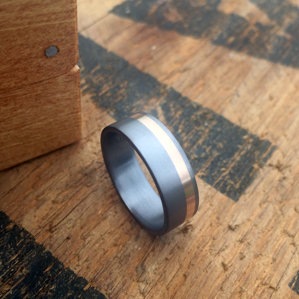 Tantalum + 18ct gold inlay ring. Comes in rose, yellow or white gold. $1610 + shipping.