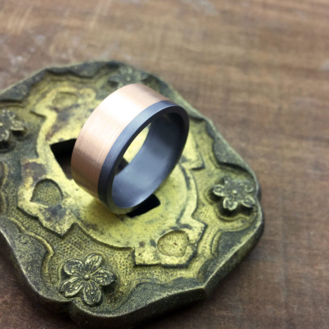 Tantalum ring with rose gold sleeve. 7.5-8.5mm wide. From $1590 for sizes up to and inc. T + shipping.