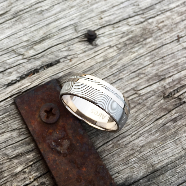 Custom Damascus steel ring with an 18ct white gold liner and 1.5mm single rail + inlay. Prices start at $2190 for up to and inc. size T .