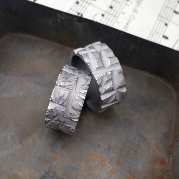 Textured titanium rings (L - ladies, R - mens). Sandblasted finish. 8-9mm wide. $550 each + shipping - all ring sizes.