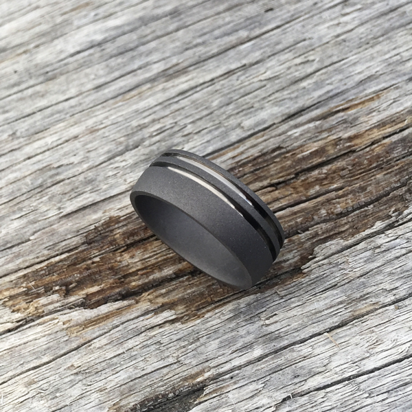 Sandblasted titanium ring with dual bands. 8.5mm wide. Round or flat profile. $550 + shipping – all sizes.