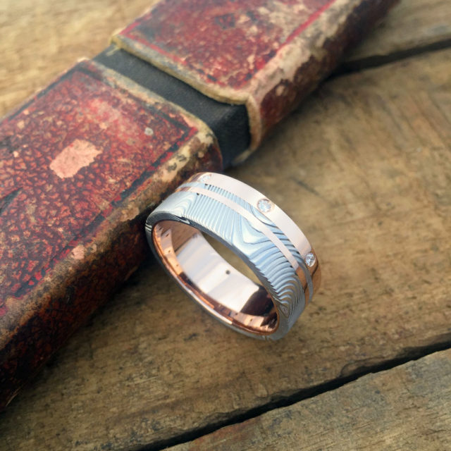 Custom Damascus and 18ct rose gold ring with brilliant cut diamonds. Priced from $3100 + shipping.