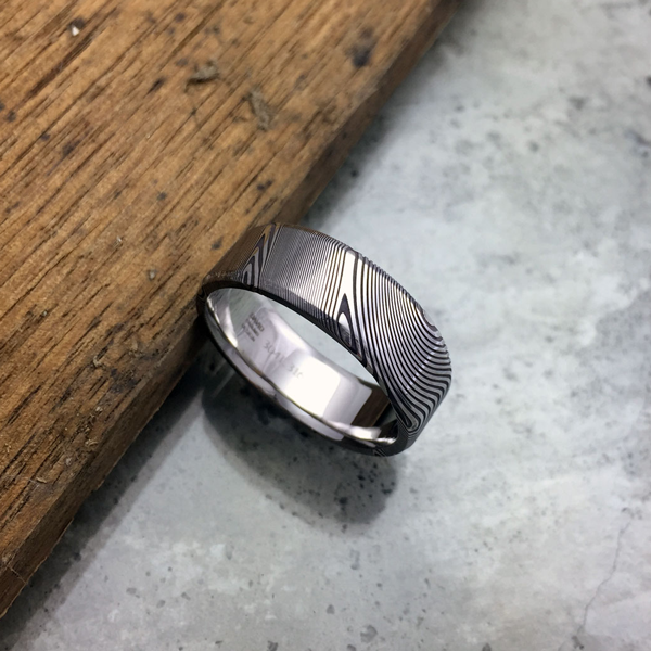 Pure Damascus steel ring. Dark etch & bevelled edges. $990 + shipping - all sizes.