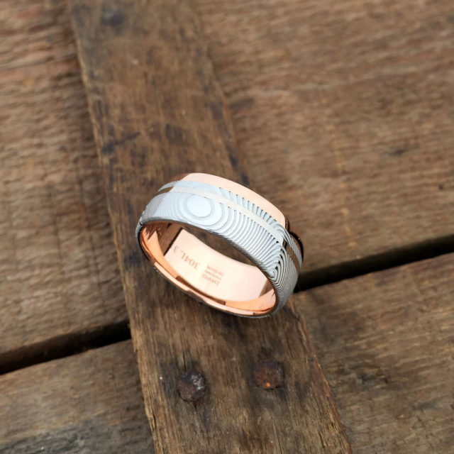 Damascus + liner, rail and inlay. 18ct rose gold liner and rail + 18ct white gold inlay. Light etch and round profile. From $2190 - see pricing tab below.