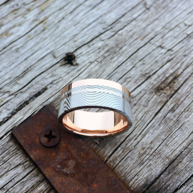 Damascus + liner, rail and inlay. 18ct rose gold liner and rail + 18ct white gold inlay. Light etch and flat profile. From $2190 - see pricing tab below.