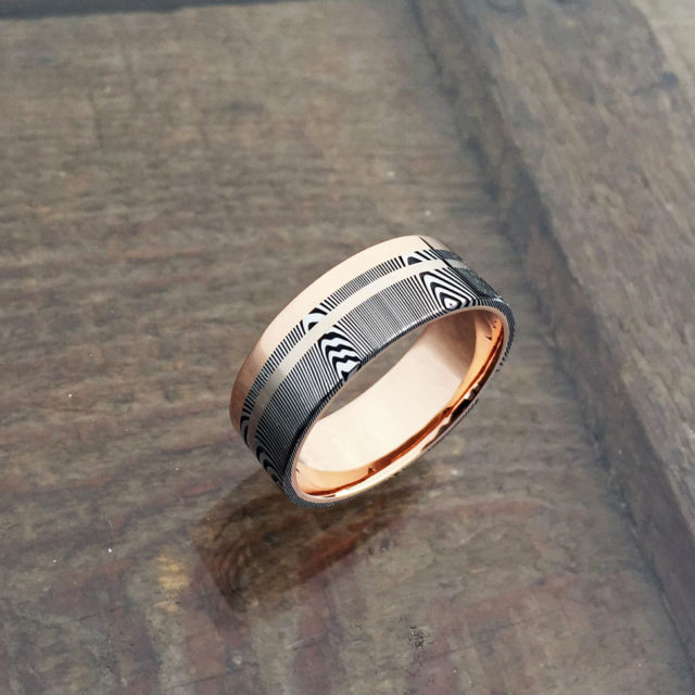 Damascus + liner, rail and inlay. 18ct rose gold liner and rail + 18ct white gold inlay. Dark etch and flat profile. From $2190 - see pricing tab below.