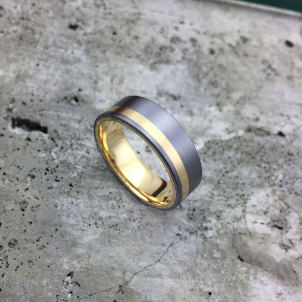 Tantalum + liner and inlay. Comes in yellow, white or rose gold. Round or flat profile. From $2040 - see pricing tab below.