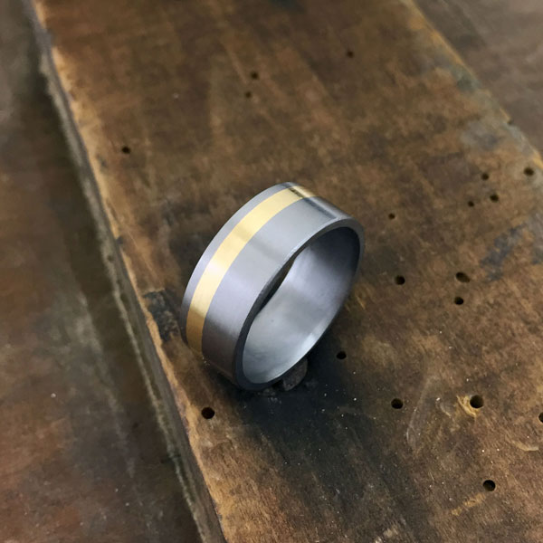 Tantalum + inlay. Comes in rose, yellow or white gold. Round or flat profile. $1550 + shipping - all sizes.